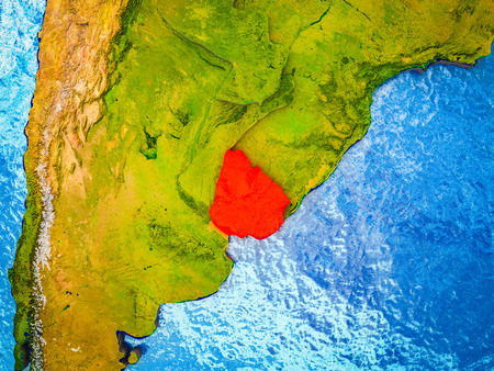 Uruguay on model of 3D Earth with blue oceans and divided countries. 3D illustration.