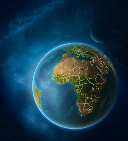 Planet Earth with highlighted Equatorial Guinea in space with Moon and Milky Way. Visible city lights and country borders. 3D illustration.