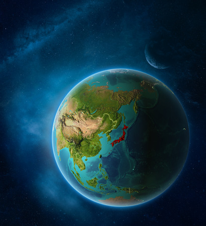 Planet Earth with highlighted Japan in space with Moon and Milky Way. Visible city lights and country borders. 3D illustration. 写真素材
