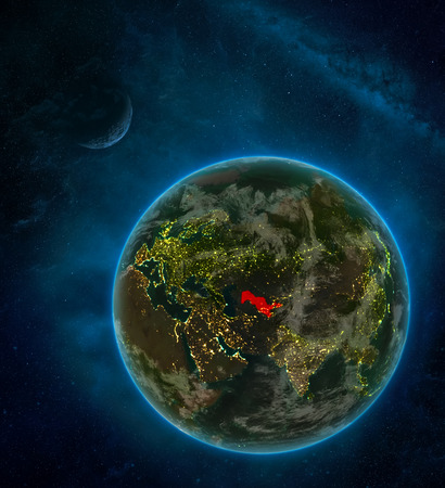 Uzbekistan from space on Earth at night surrounded by space with Moon and Milky Way. Detailed planet with city lights and clouds. 3D illustration. Stock Photo