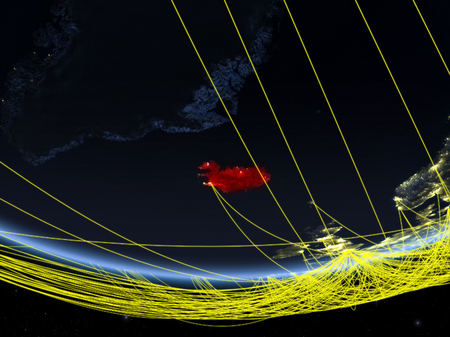 Iceland on model of planet Earth at night with network representing travel and communication. 3D illustration. Stock Photo