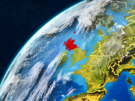 Scotland on realistic model of planet Earth with country borders and very detailed planet surface and clouds. 3D illustration. Banco de Imagens