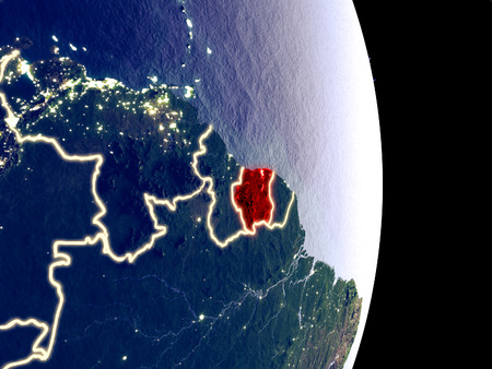 Satellite view of Suriname at night with visible bright city lights. Extremely fine detail of the plastic planet surface. 3D illustration.