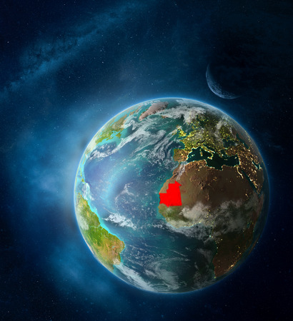 Mauritania from space on Earth surrounded by space with Moon and Milky Way. Detailed planet surface with city lights and clouds. 3D illustration.