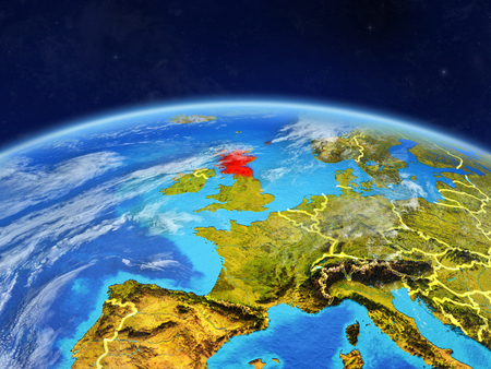 Scotland on planet Earth with country borders and highly detailed planet surface and clouds. 3D illustration. Stock Photo