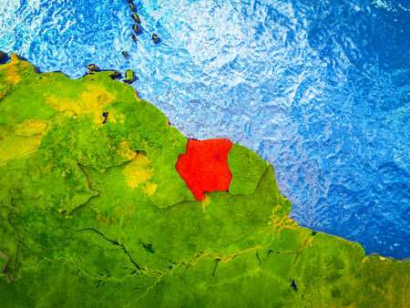 Suriname on model of 3D Earth with blue oceans and divided countries. 3D illustration. Stock Photo