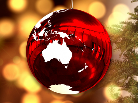 Australia on red shiny Chrismas ball with candle lights blurred in the background. 3D illustration. Stock Photo