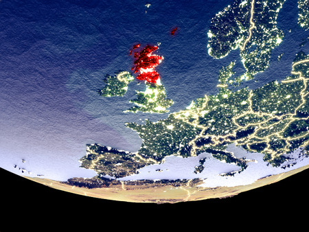 Satellite view of Scotland from space at night. Beautifully detailed plastic planet surface with visible city lights. 3D illustration. Stock Photo