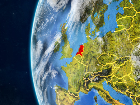 Netherlands from space on model of planet Earth with country borders and very detailed planet surface and clouds. 3D illustration.