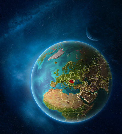 Planet Earth with highlighted Romania in space with Moon and Milky Way. Visible city lights and country borders. 3D illustration. Imagens