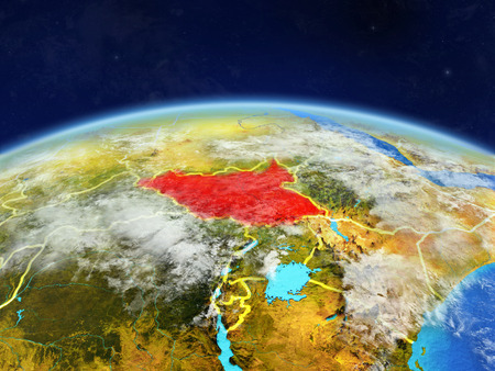 South Sudan on planet Earth with country borders and highly detailed planet surface and clouds. 3D illustration.