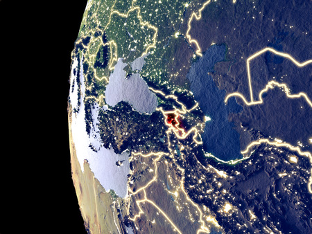 Night view of Armenia from space with visible city lights. Very detailed plastic planet surface. 3D illustration.