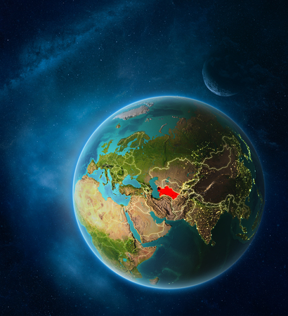 Planet Earth with highlighted Turkmenistan in space with Moon and Milky Way. Visible city lights and country borders. 3D illustration.