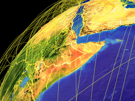Horn of Africa from space on Earth with lines representing international connections, communication, travel. 3D illustration.