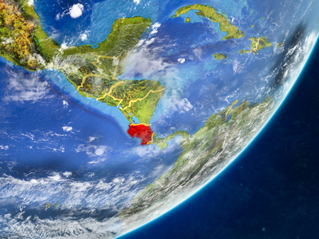 Costa Rica on model of planet Earth with country borders and very detailed planet surface and clouds. 3D illustration. 版權商用圖片