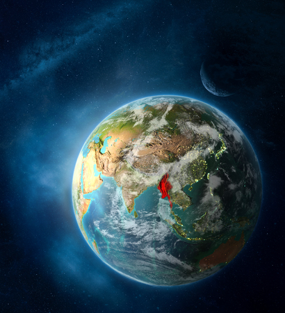 Myanmar from space on Earth surrounded by space with Moon and Milky Way. Detailed planet surface with city lights and clouds. 3D illustration. Imagens
