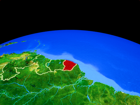 French Guiana on model of planet Earth with country borders and very detailed planet surface. 3D illustration.