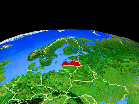 Latvia on model of planet Earth with country borders and very detailed planet surface. 3D illustration. Stock Photo