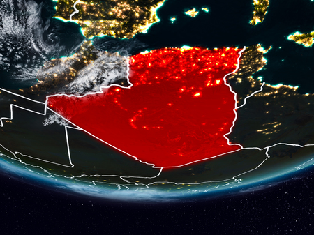 Algeria on Earth at night with visible country borders. 3D illustration. Stock Photo