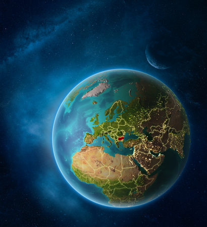 Planet Earth with highlighted Bulgaria in space with Moon and Milky Way. Visible city lights and country borders. 3D illustration.