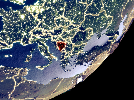Bosnia and Herzegovina from space on model of Earth at night. Very fine detail of the plastic planet surface and visible bright city lights. 3D illustration.