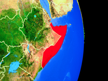 Somalia on realistic model of planet Earth with country borders and very detailed planet surface. 3D illustration. Stock Photo
