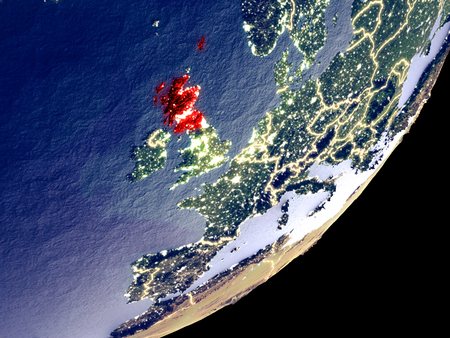 Scotland from space on model of Earth at night. Very fine detail of the plastic planet surface and visible bright city lights. 3D illustration. Stock Photo