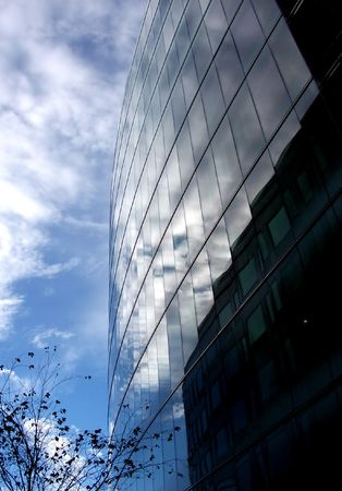 docklands: A modern glass building in Londons docklands . Stock Photo
