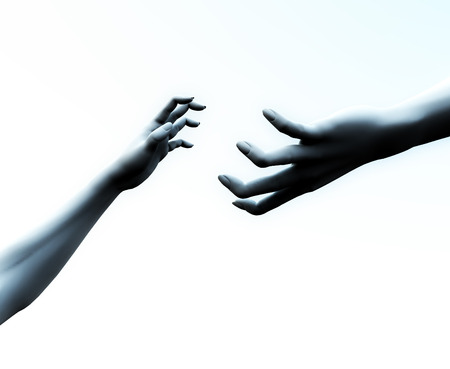 An image of two hands reaching out for each other a possible concept for reaching out a helping hand of friendship. photo