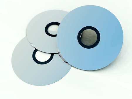 dvds: An image of what could be some DVDs or CDs.