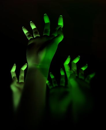 An image for Halloween showing a lot of zombie like hands outreaching Stock Photo - 1829518