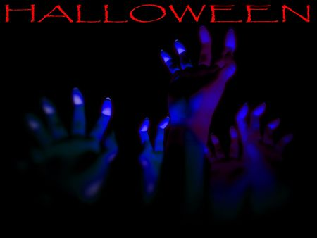 An image for Halloween showing a lot of zombie like hands outreaching in the darkness. Stock Photo - 1829520