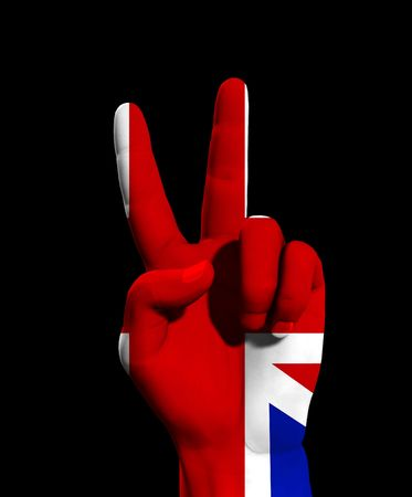 brit: A conceptual image of hand with the UK flag, that could symbolise,freedom,peace,winning and victory.