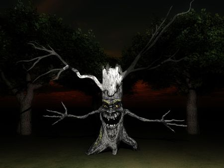 menacing: An image of a smiling but menacing spooky tree, it would make a good Halloween image. Stock Photo
