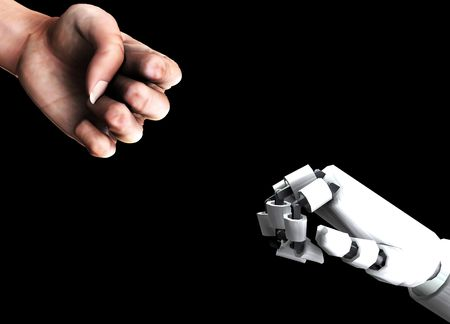 A conceptual image of a human verses robot fist, that could represent the concepts of aggression,battle or power. Stock Photo - 2162821
