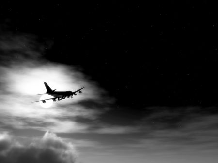 A plane flying high in the moonlight sky. photo