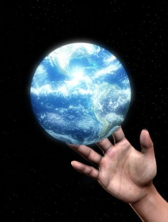 A conceptual image of a greedy hand about to grab control over the world. photo