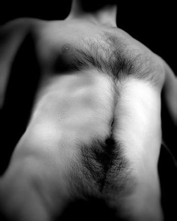 naked male body: A nude torso section of a human male.