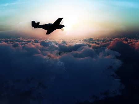 aeronautical: A plane flying over some clouds.