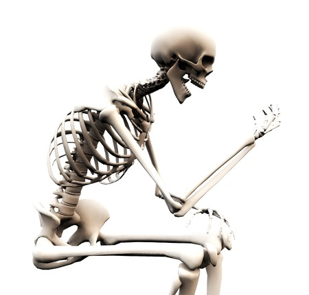 halloween skeleton: A skeleton looking at its own bony hand. Stock Photo