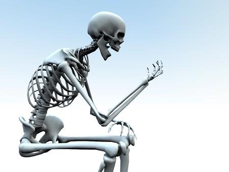 bony: A skeleton looking at its own bony hand. Stock Photo