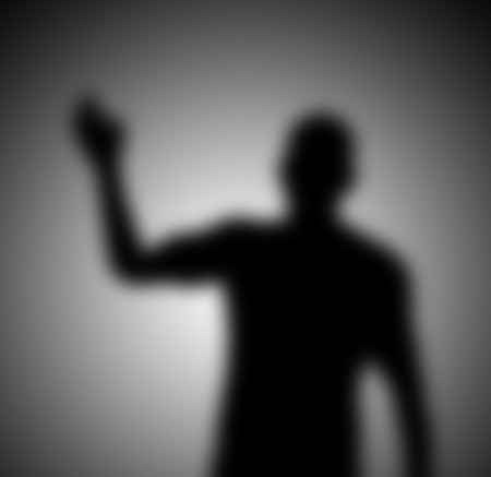 shadowy: A mysterious and blurry waving shadow figure. Stock Photo