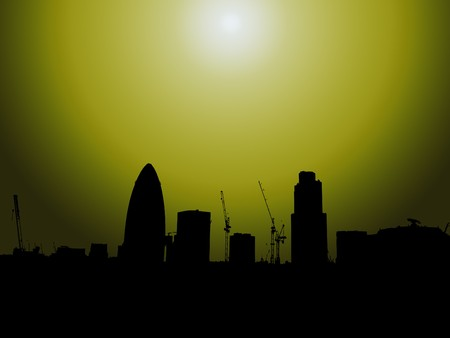 The London skyline in silhouette with the Gherkin. photo