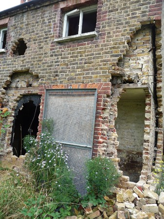 derelict: A hole in a derelict house.