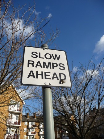 instructional: A slow ramp warning sign.