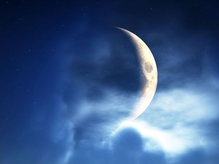 nightime: A crescent moon in a cloudy night time sky.