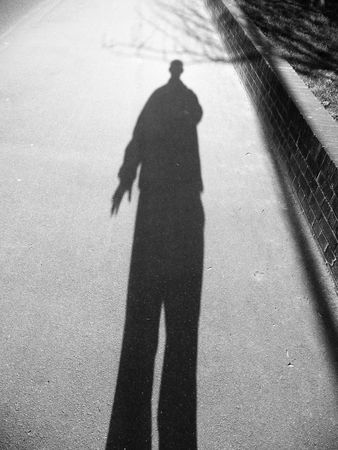 shadowy: A black and white shadowy image of a man.