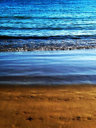 Water waves washing up onto the sandy beach. Stock Photo - 6389817