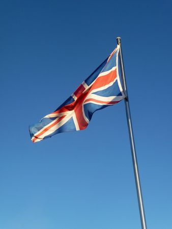 The union jack flag blowing in the wind. photo