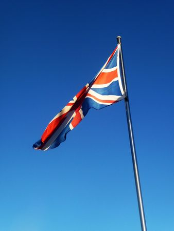 brit: The union jack flag blowing in the wind. Stock Photo